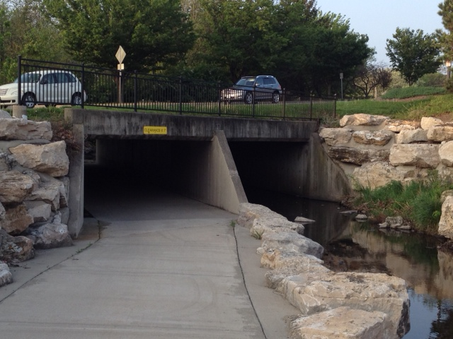 A grade-separated road crossing added to an existing culvert.