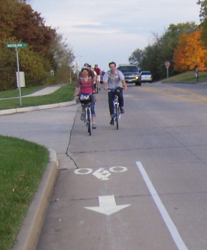 Bicyclists use one of the bike lanes.