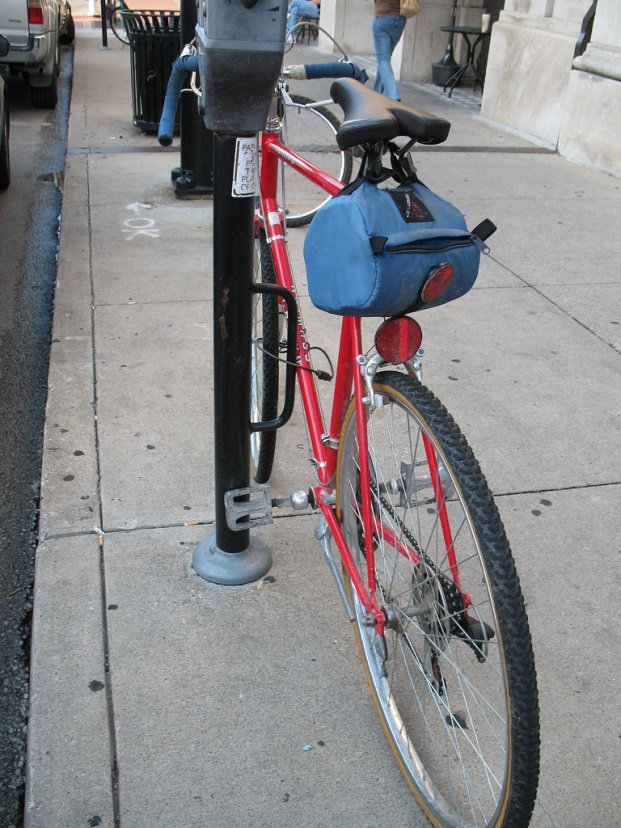 Parking meters in downtown Columbia are outfitted with metal loops for bike parking.